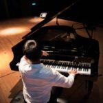 back-view-grand-piano-man-2378209